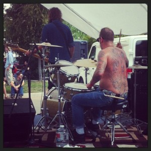 The drummer of this heavy metal band had a full back tat of the Virgin Mary.