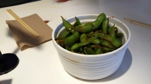 Use a chopstick to stir up the spicy edamame, to coat it with the chili oil that invariably ends up in the bottom of the cup.