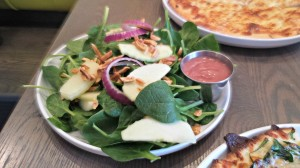 The Spinach Salad has toasted almonds along with Granny Smith apple slices, bacon and onion.